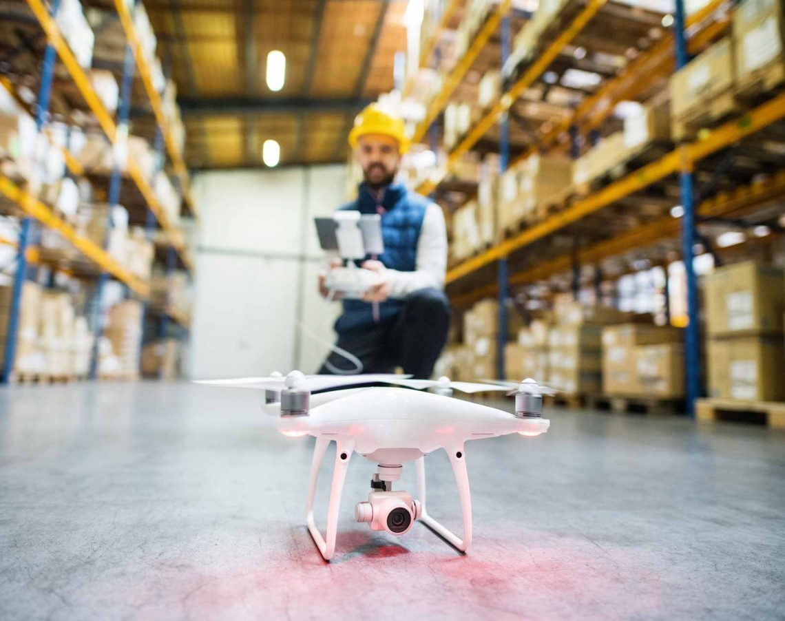 man-with-drone-in-a-warehouse-PMQEJ35.jpg